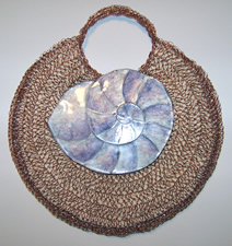 crocheted copper wire, liquid polymer clay nautilus shell purse